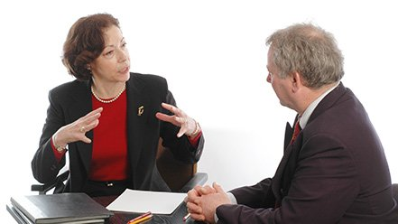 Man and woman talking about THE EIGHT PRINCIPLES CURRICULUM